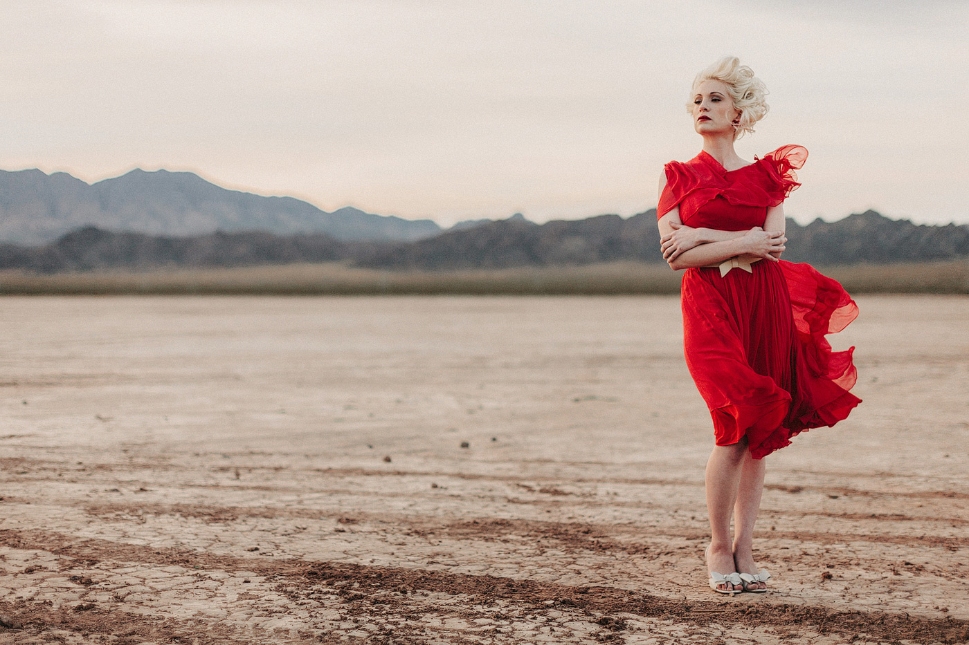 girl in red dress salt flats nevada