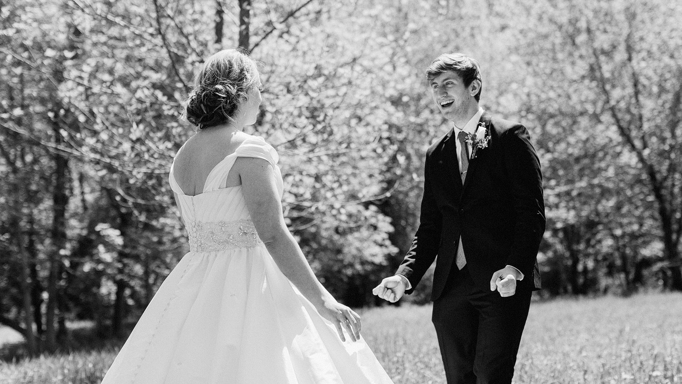 excited groom first look des moines iowa photographer