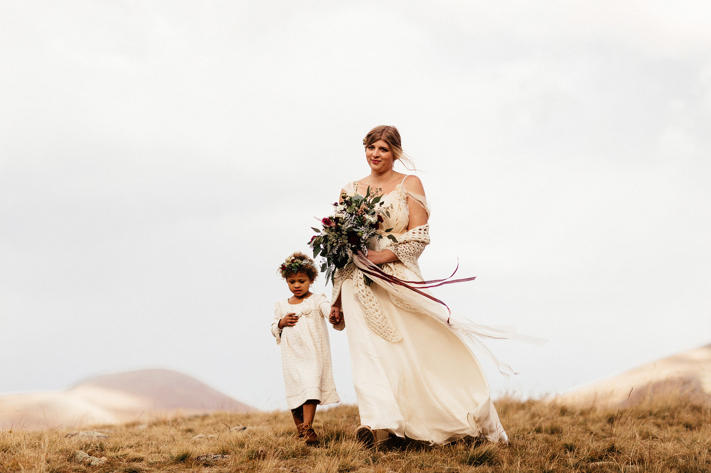 younger sister walks bride down the aisle colorado mountain wedd