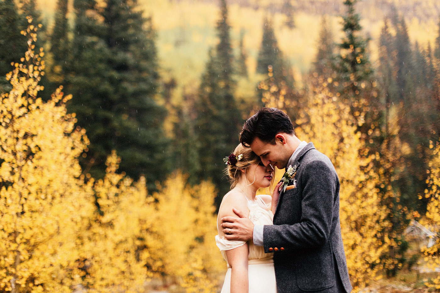 fall colors wedding aspens and evergreens bridal portrait intima