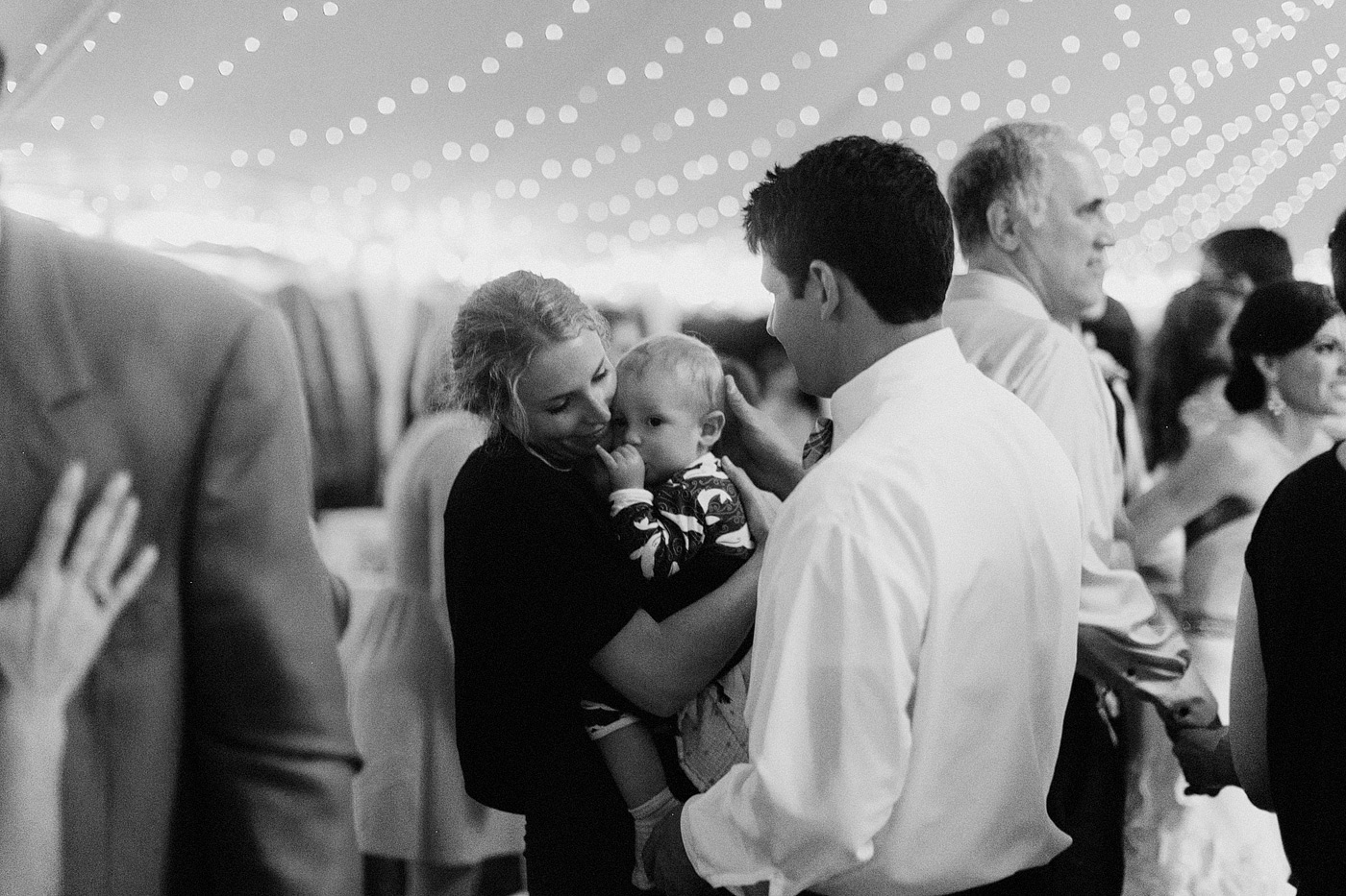 touching moment with mother father and son on wedding reception