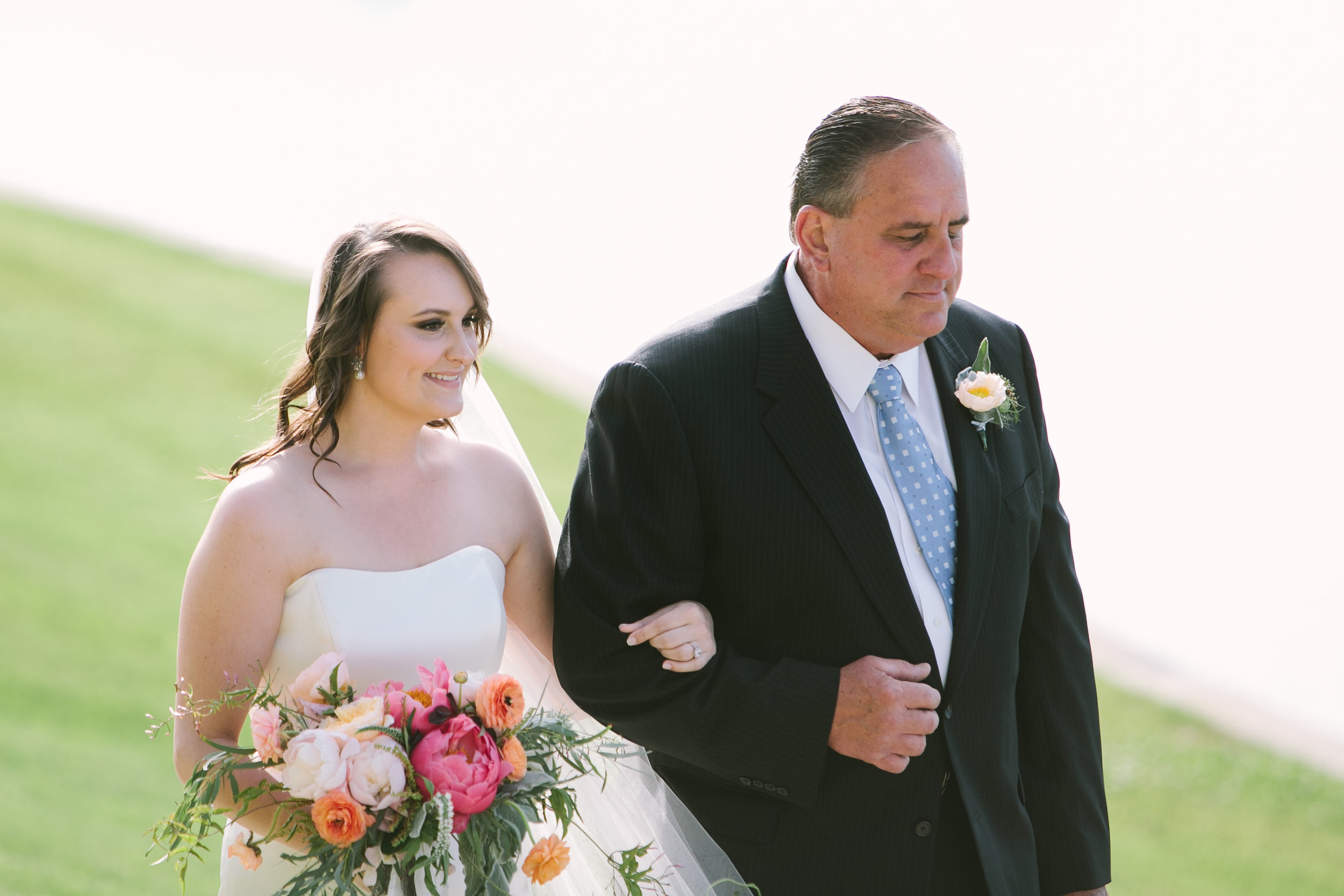 This is what I'm talking about Kelsey Tice Photography... the sweetest moment captured as my dad is walking my sister down the aisle.