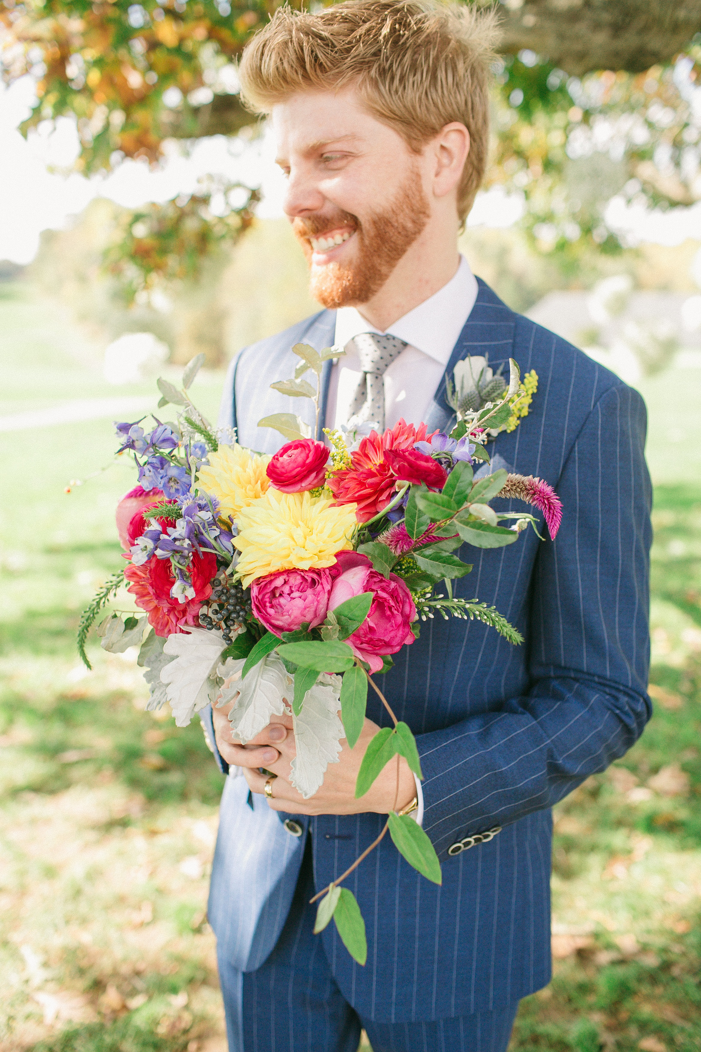 I feel like Sean has a Damian Lewis' little brother vibe going on...maybe I've just been watching too much Homeland lately.  Maggie's bouquet is filled with dusty miller, various pink garden roses, lysmachia, blue virburnum berry, dahlias, fuchsia celosia, blue delphenium, mardi gra solidago, ranunculus, cornflower, kochia, and foraged vine, wild olive, and bittersweet.
