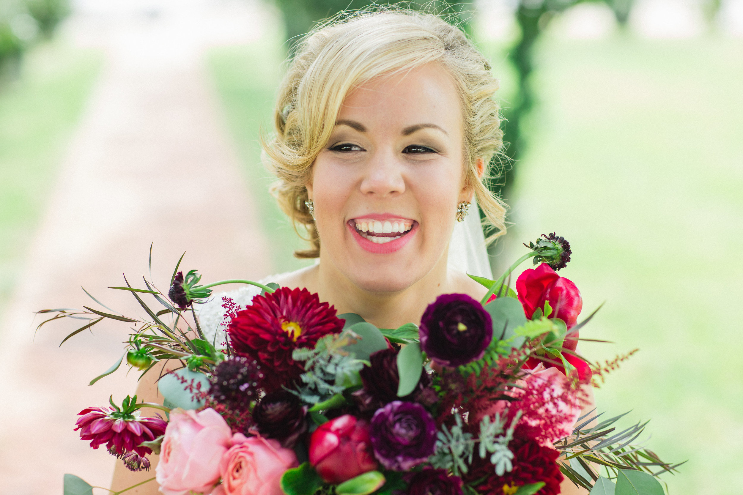 Hannah's bouquet was filled with dahlias, garden roses, ranunculus, peonies, scabiosa, acacia foliage, feather eucalyptus, silver dollar eucalyptus,  astilbe, and fern.