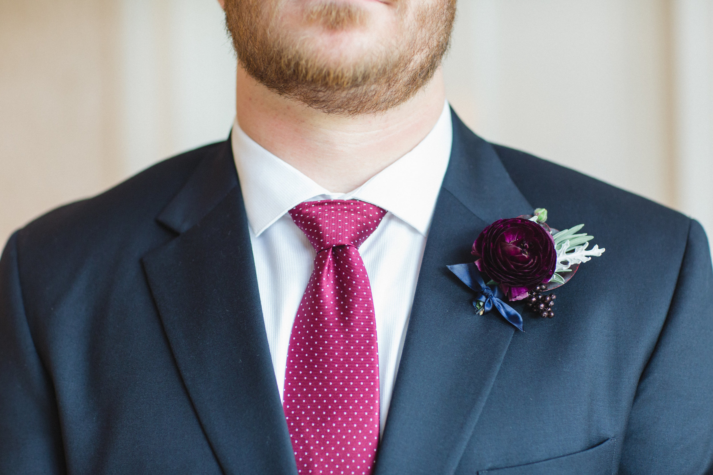 John's boutonniere was made of dusty miller, silver dollar eucalyptus, painted berries, and a ranunculus.