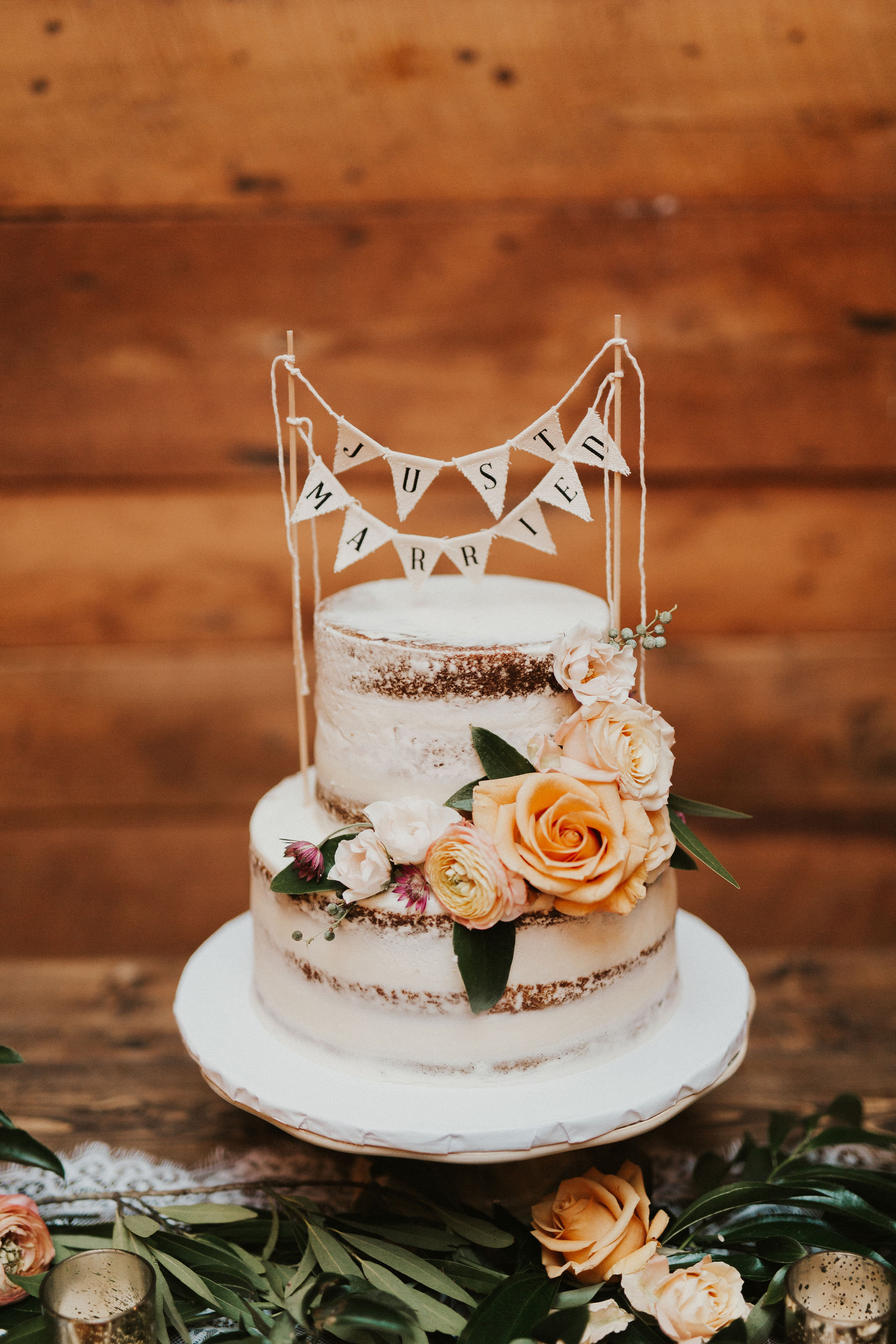 naked wedding cake with flowers