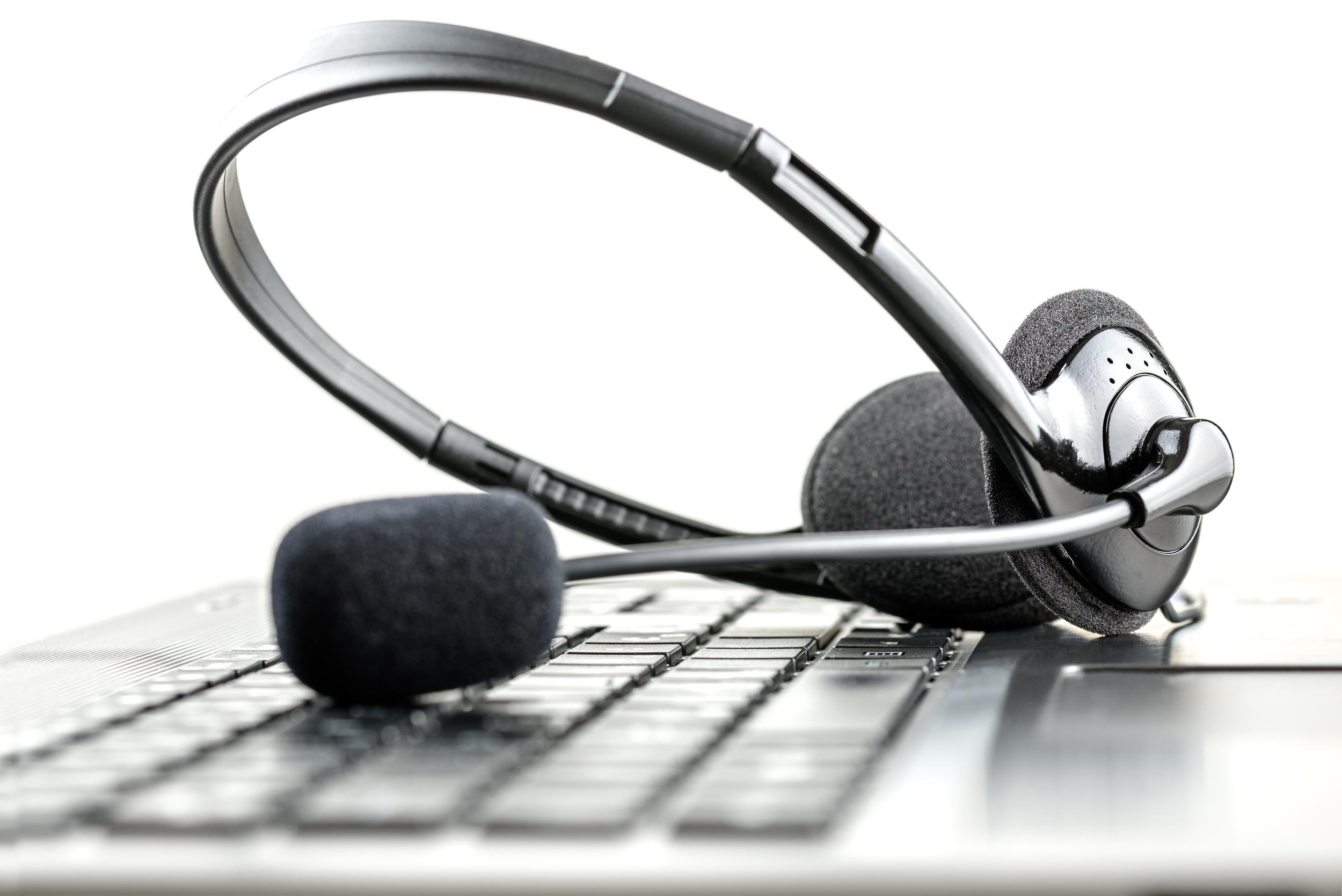 bigstock-Headset-On-A-Laptop-Computer-61846175.jpg