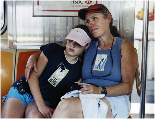Grace Phelps, 12, and her mother Shirley Phelps, 47, on the 7 train heading to the next protest. New York, NY 2005.