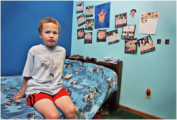 Luke Phelps-Roper, 6, shows off his bedroom. Topeka, KS. 2008.