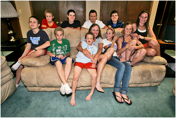 The family sits down for a family photo in their game room. Topeka, KS 2008.