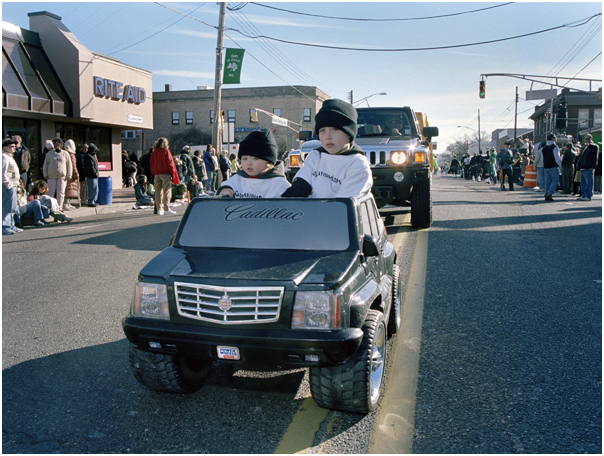 Brothers ride in mini Cadillac at St. Patrick's Day parade. Belmar, NJ. 2008.