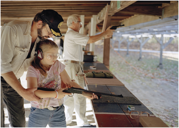 Little girl learning how to shoot at the range. East Windsor, NJ 2005.
