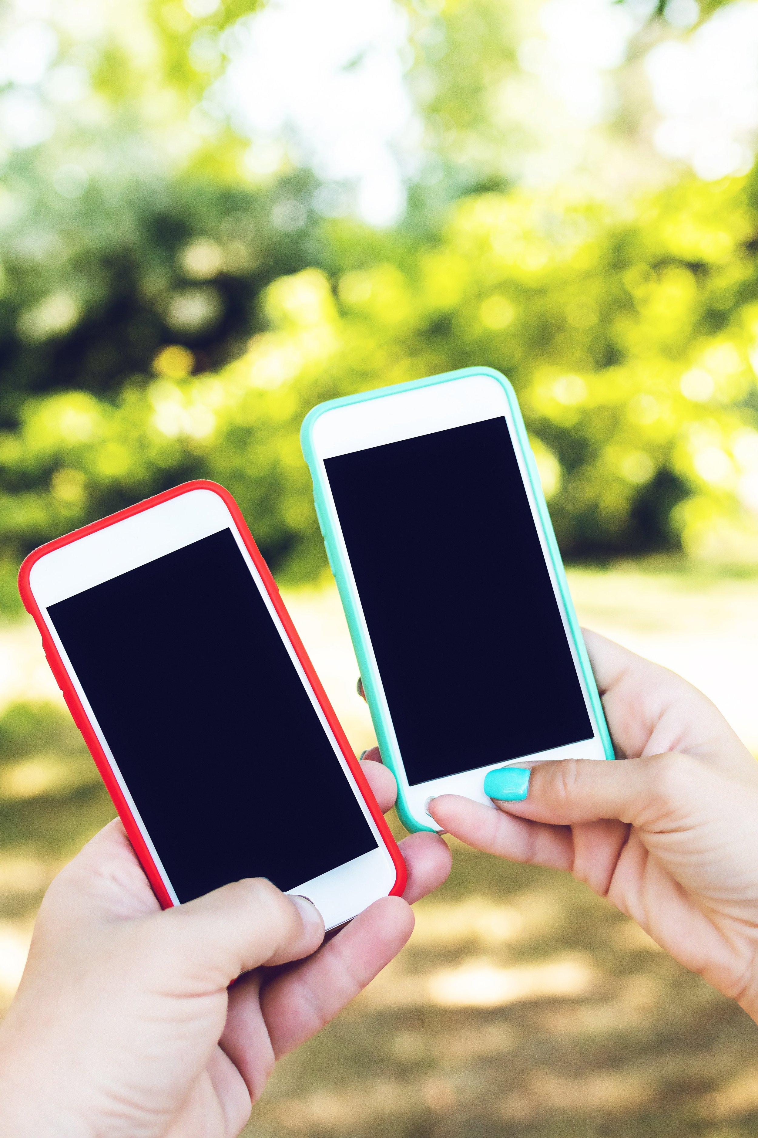 cellphones-holding-mobile-phones-2606516.jpg