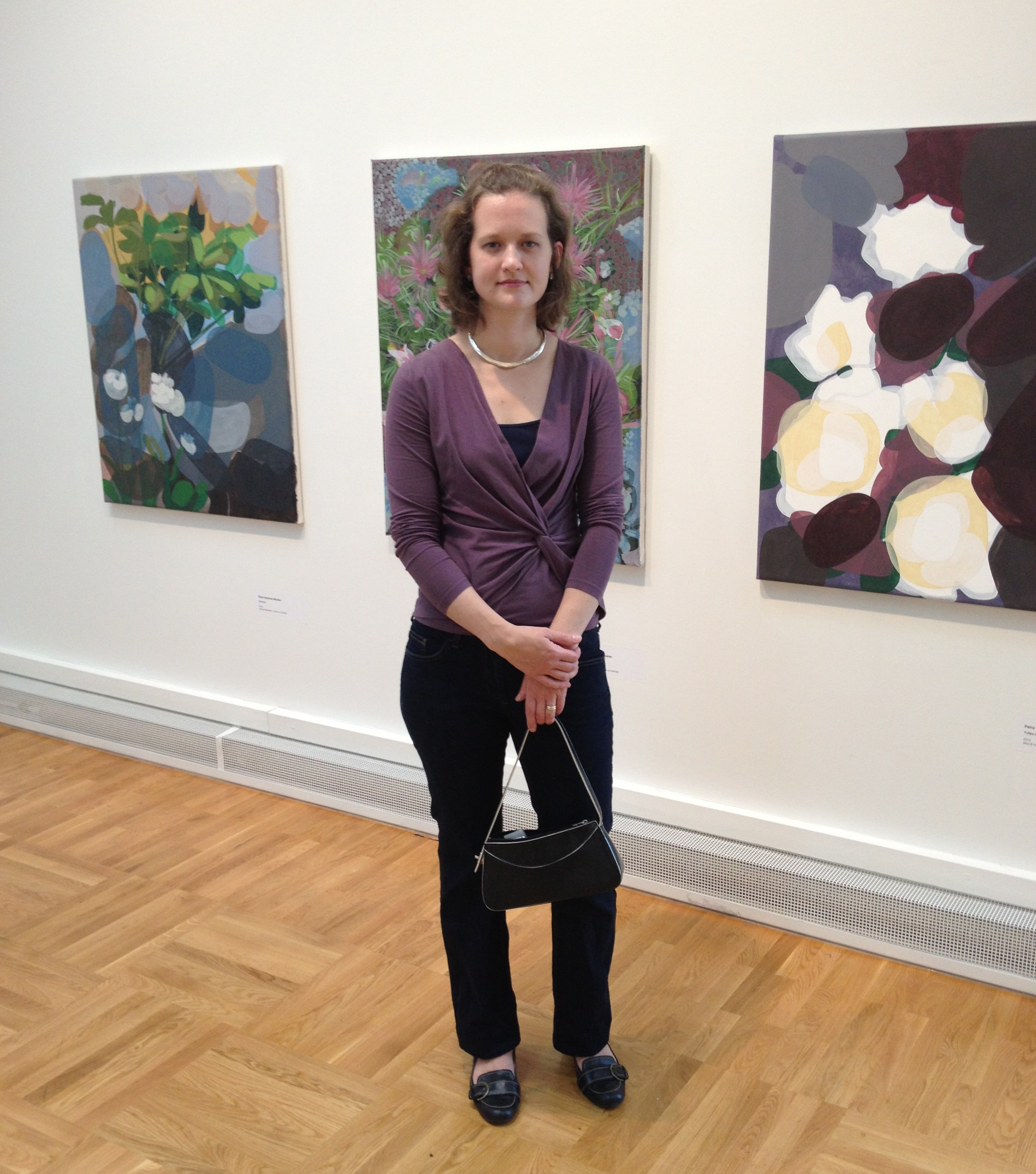 Artist infront of Paintings