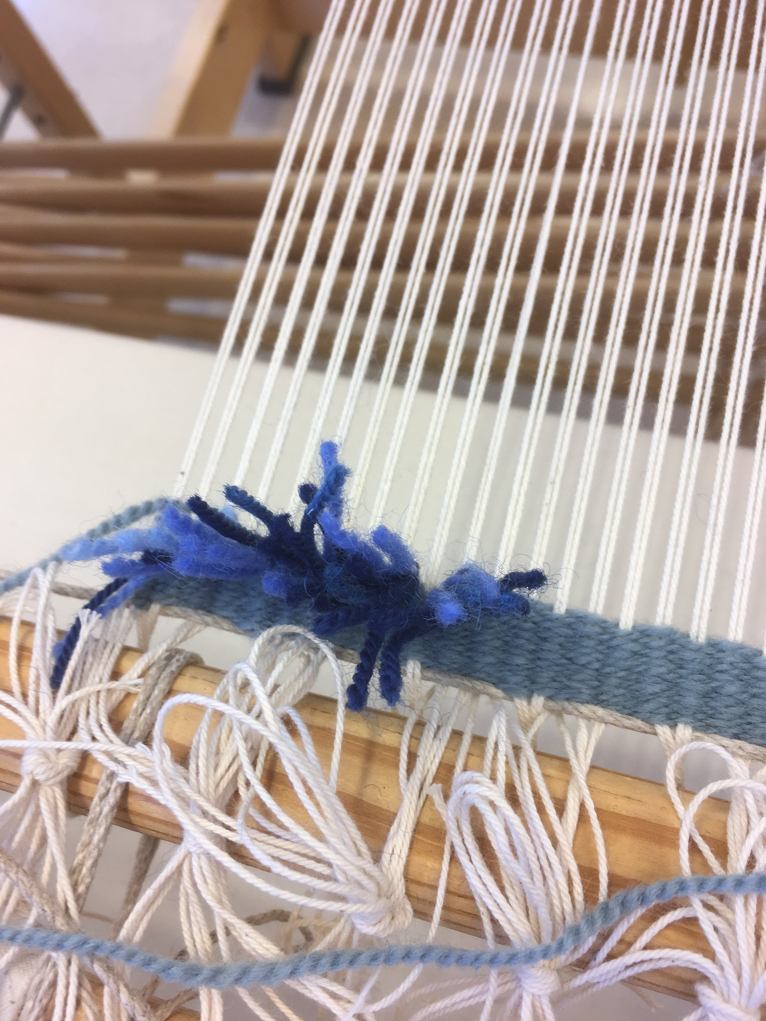 """First knots on the loom for the construction of """"Revisiting the Past"""" (Old Bonfire)"""" tufted tapestry, aka ryijy."""