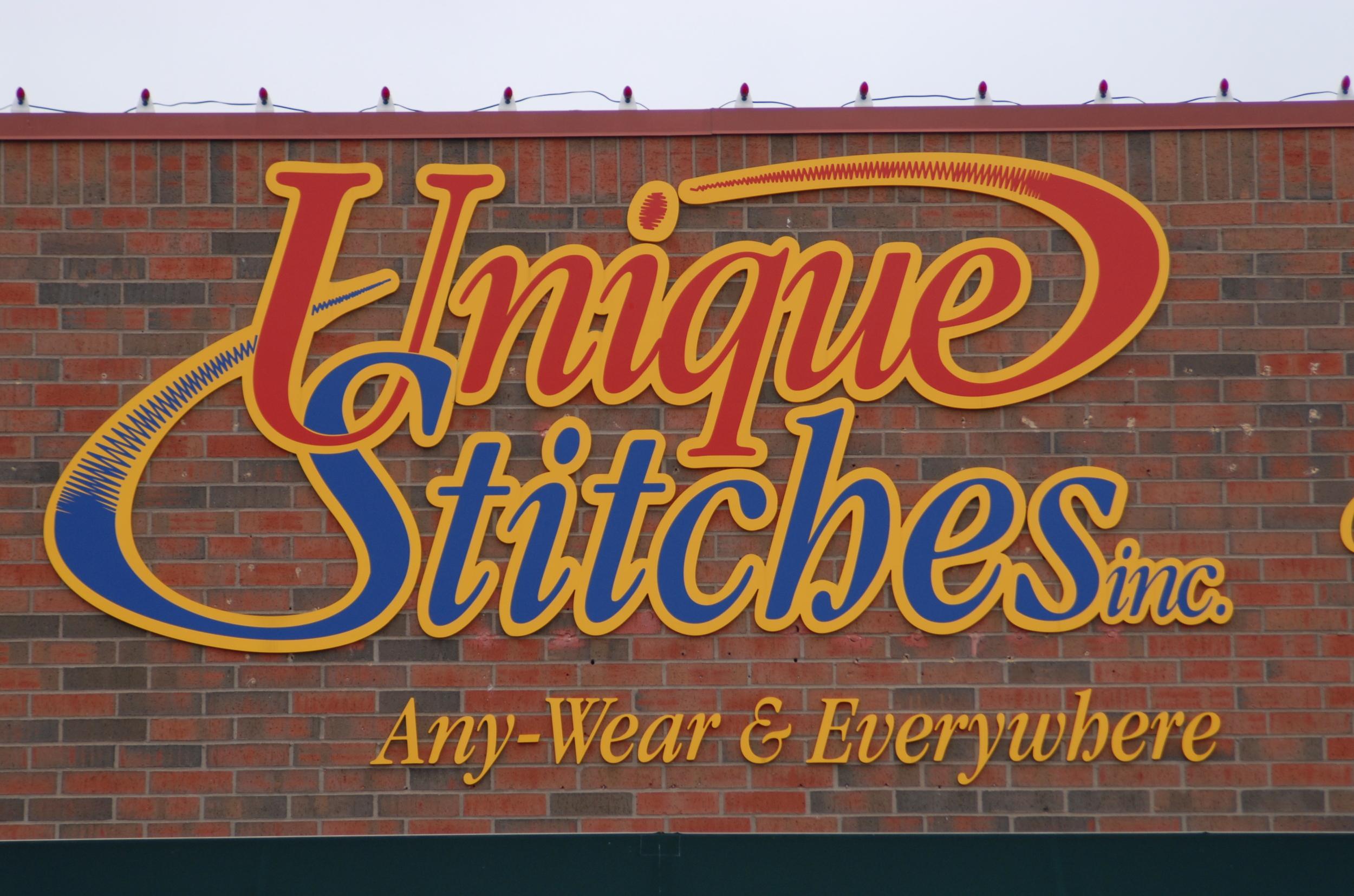 Unique Stitches storefront sign.