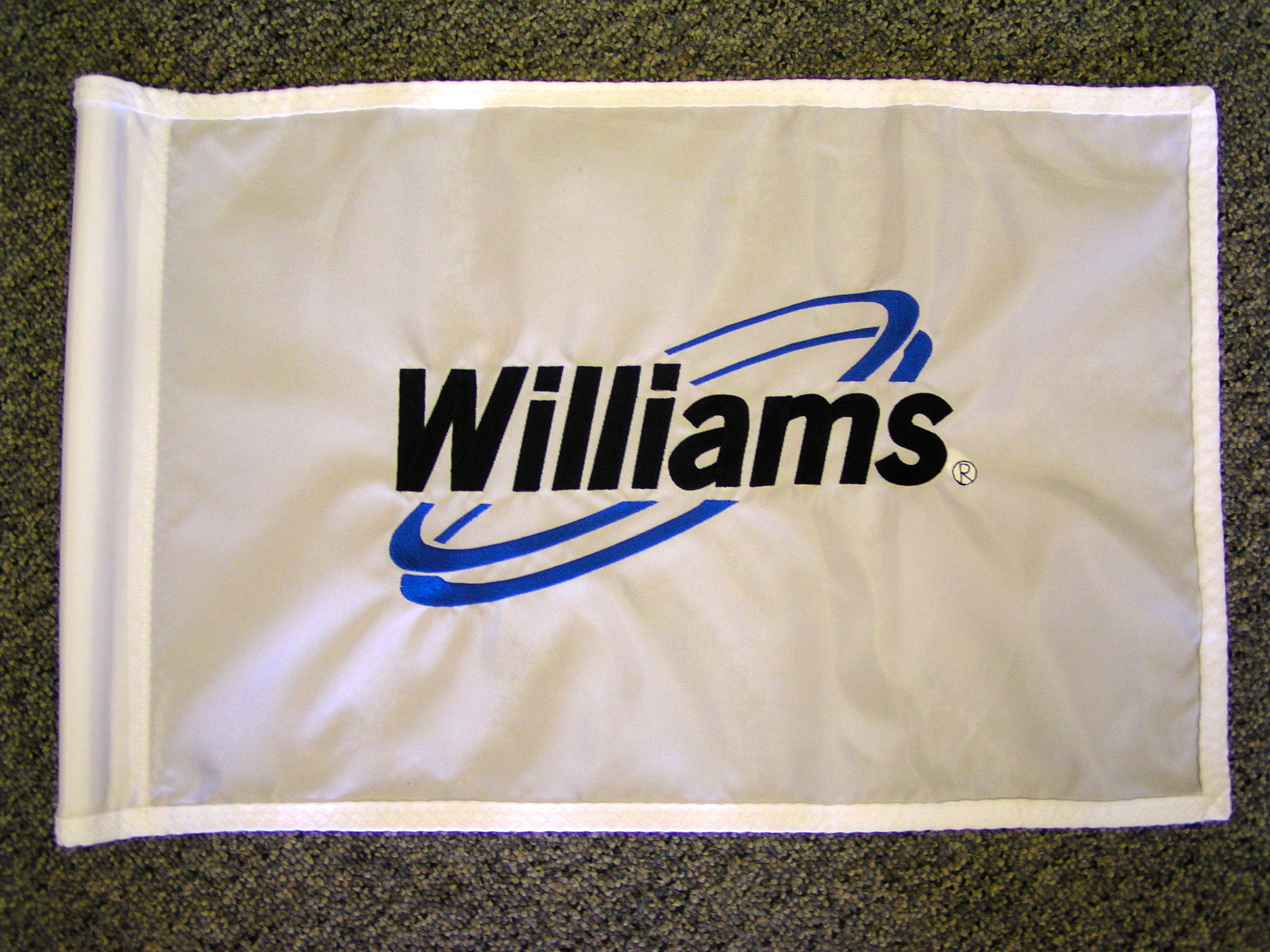 Embroidered logo on golf flag.