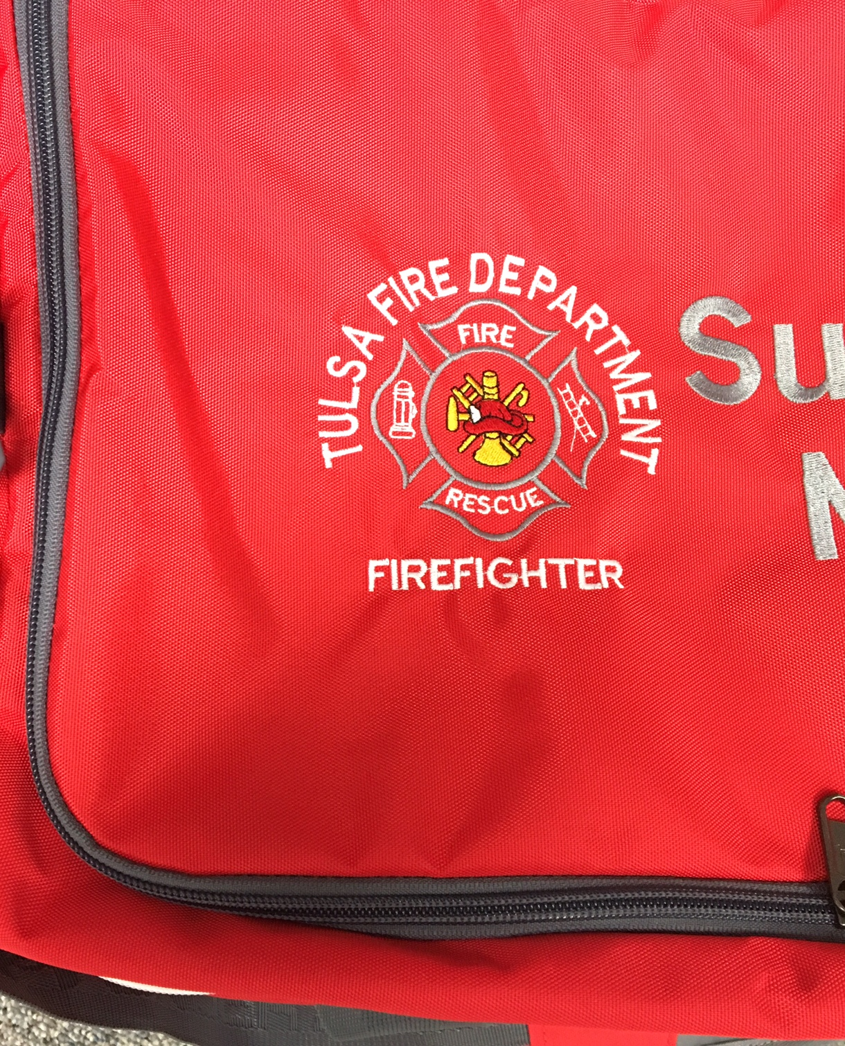 TFD logo on duffel bag.
