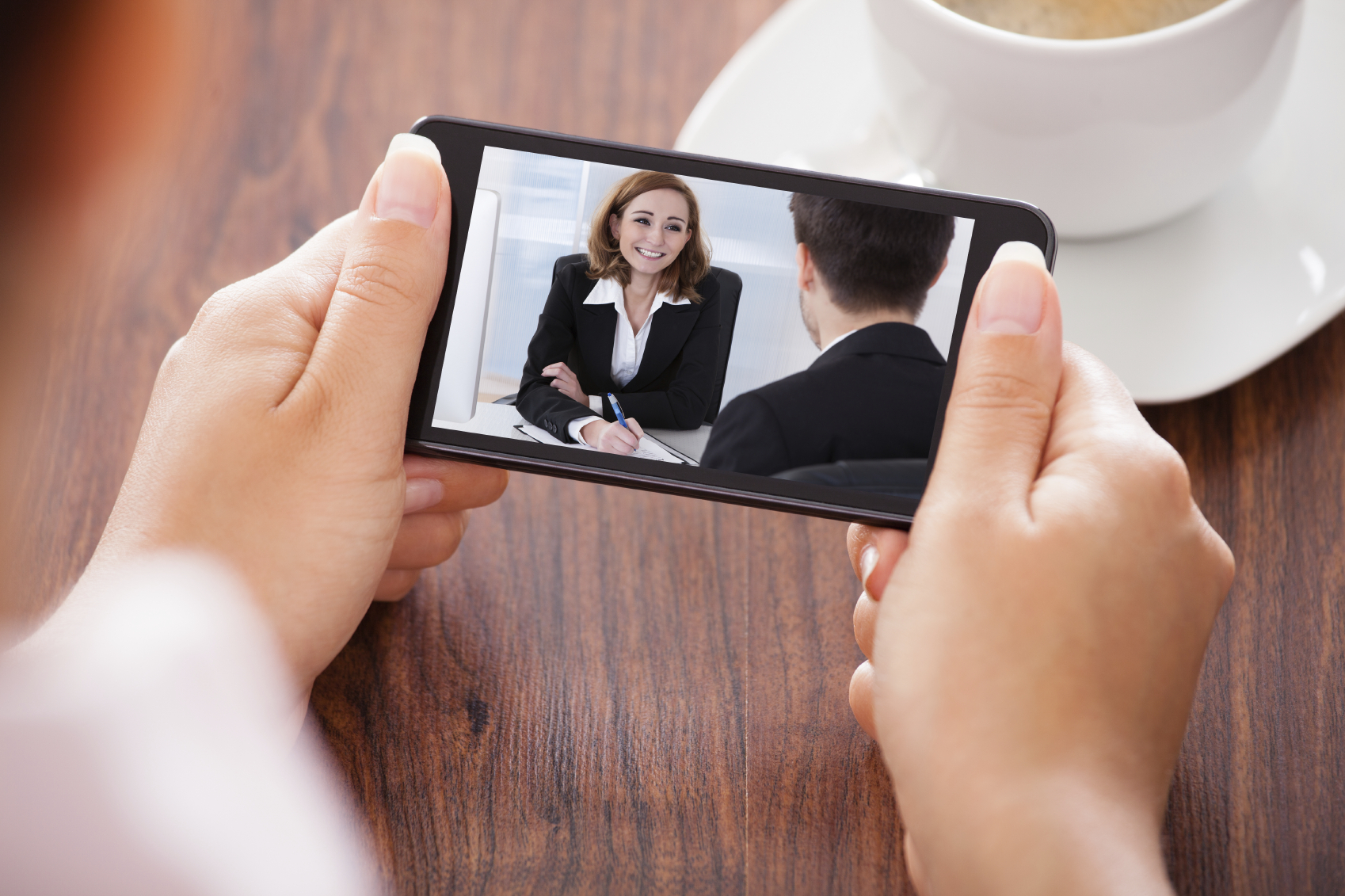 Watching a training video on a mobile phone