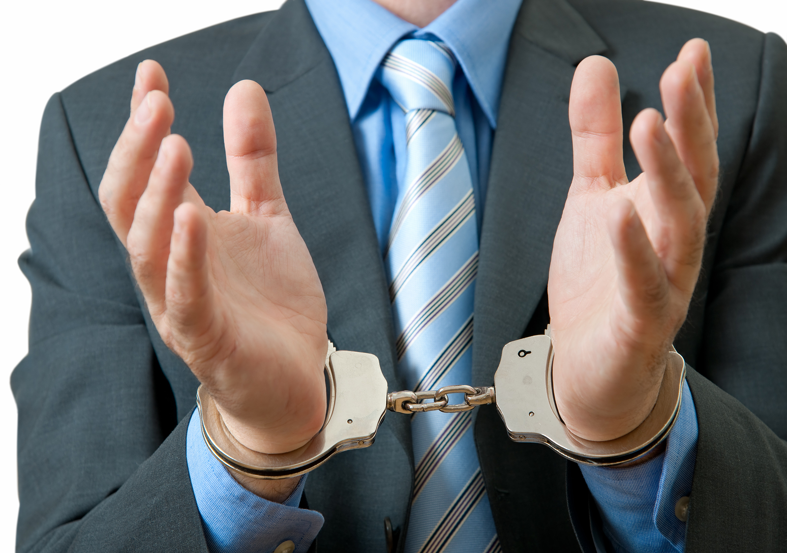 A customer service employee with hands in handcuffs to signify that he is unable to do anything to help customers.