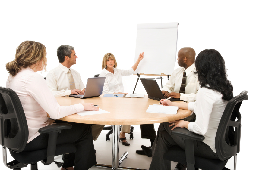 A group of business colleagues sitting around a conference table.