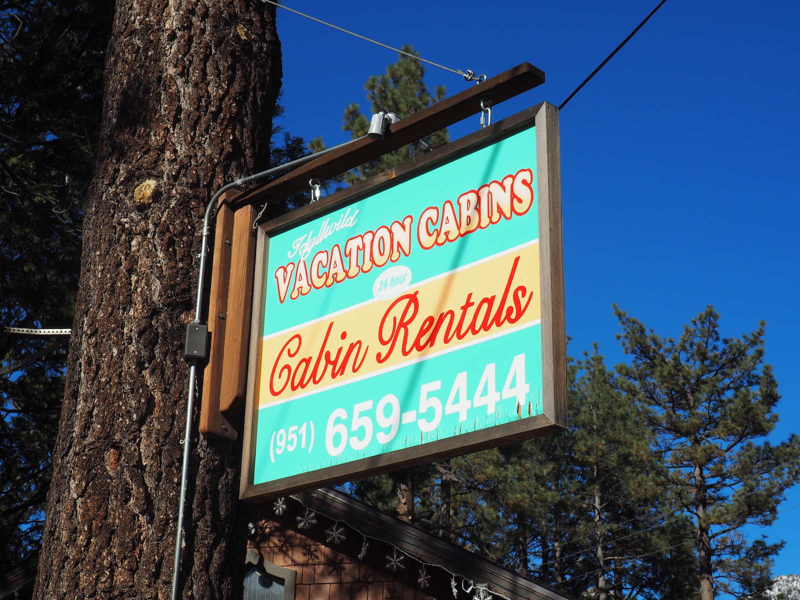 Sign from the Idyllwild Vacation Cabins storefront in the town of Idyllwild, CA.