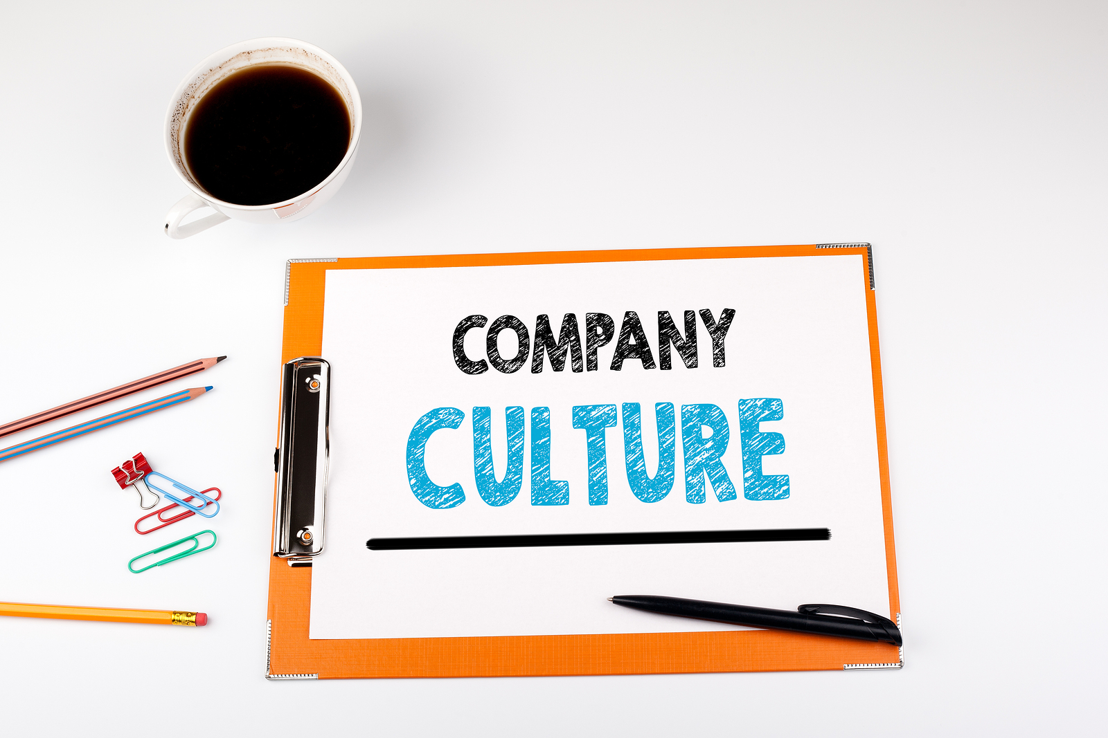 """Clip board with paper on it that reads """"Company Culture."""""""