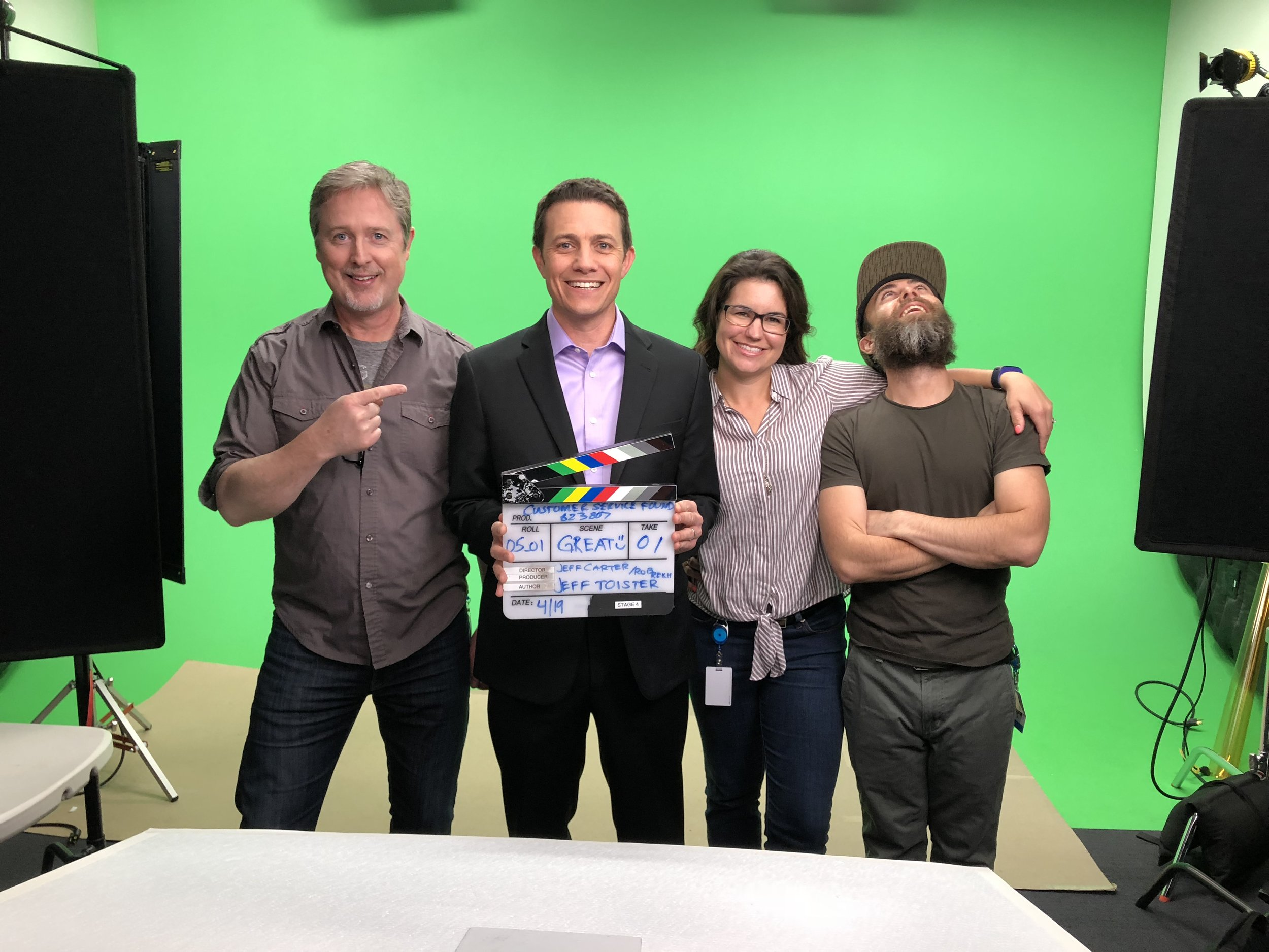 On the set filming Customer Service Foundations. From left to right: Jeff (Director), Jeff (me), Sam (Producer), and Rob (Production Lead).
