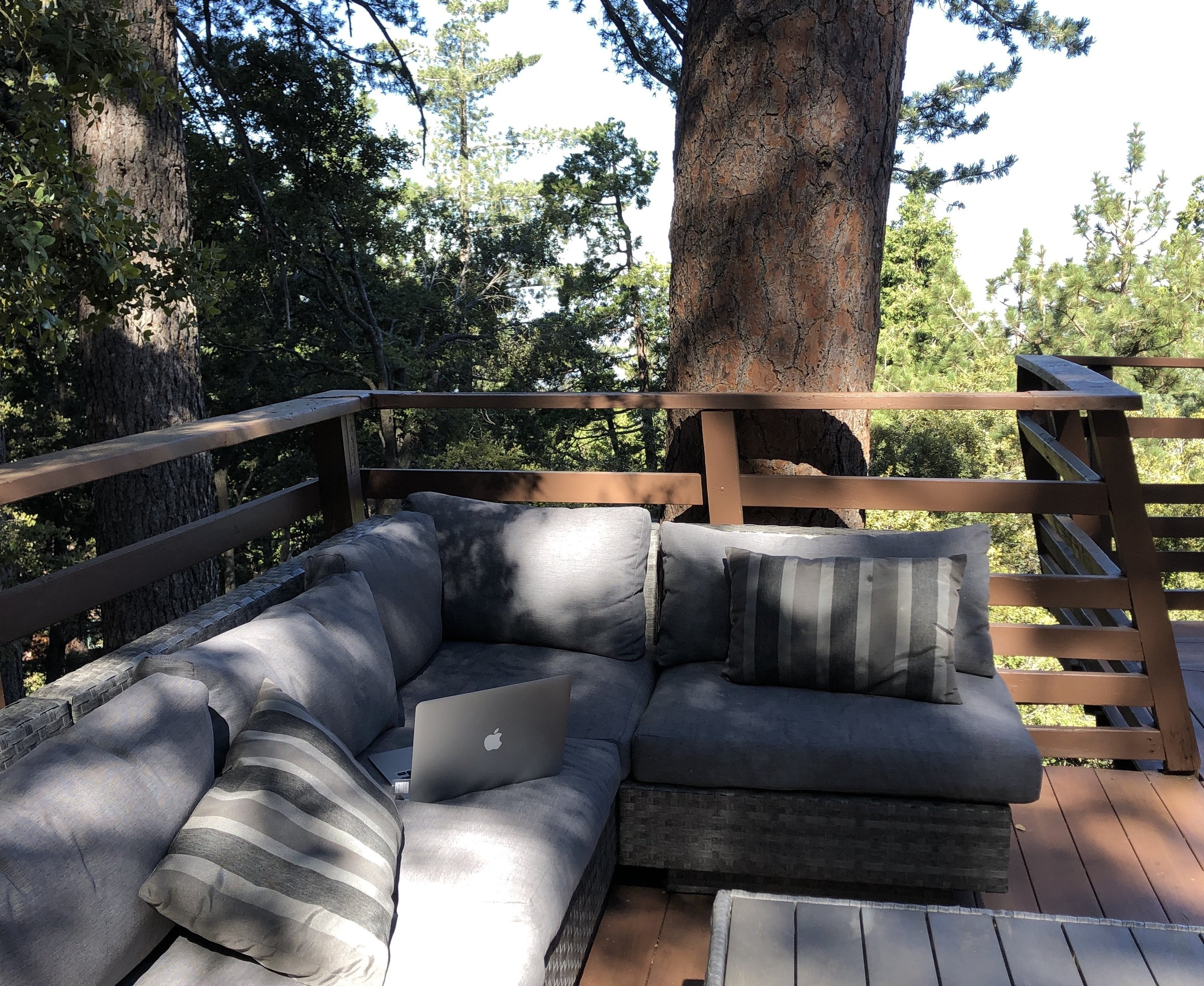 Beautiful day on the outdoor couch on the deck outside The Overlook.