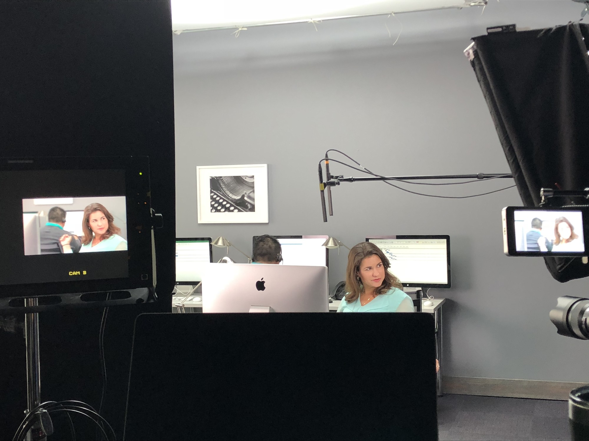 Filming a customer service training video on a contact center set.