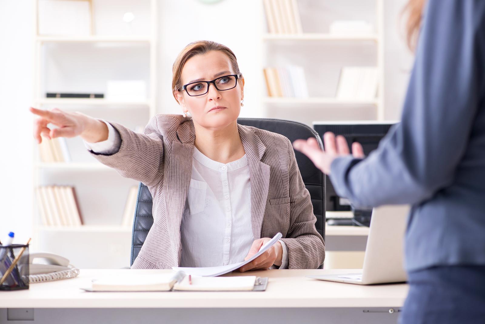 An angry boss firing an employee.