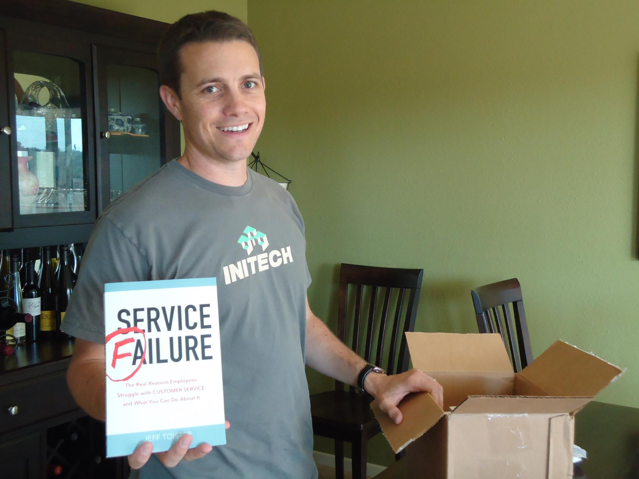 The author holding up a defective copy of his book, Service Failure.
