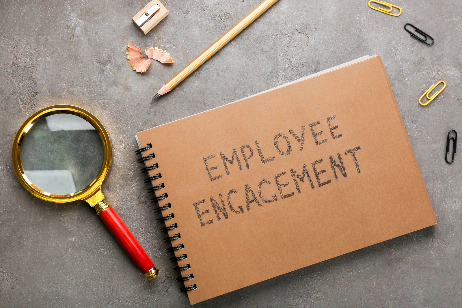 "Notebook with the words ""employee engagement"" written on the front."