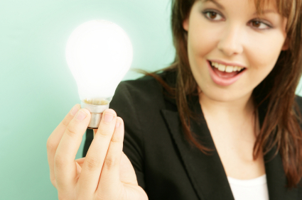 A woman holding a lightbulb signifying a bright idea.