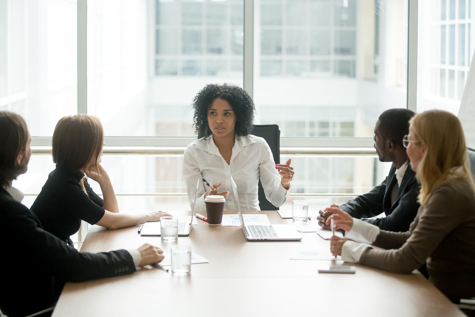 Customer service leader facilitating a team meeting.