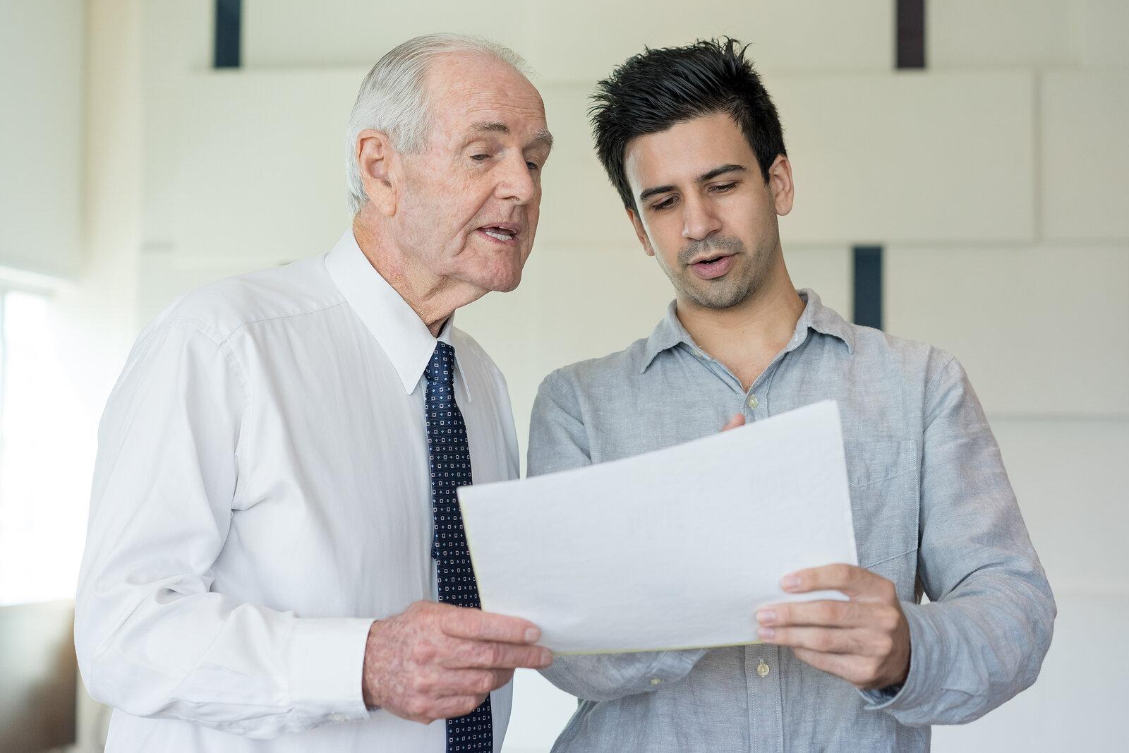 A senior leader mentoring an employee.