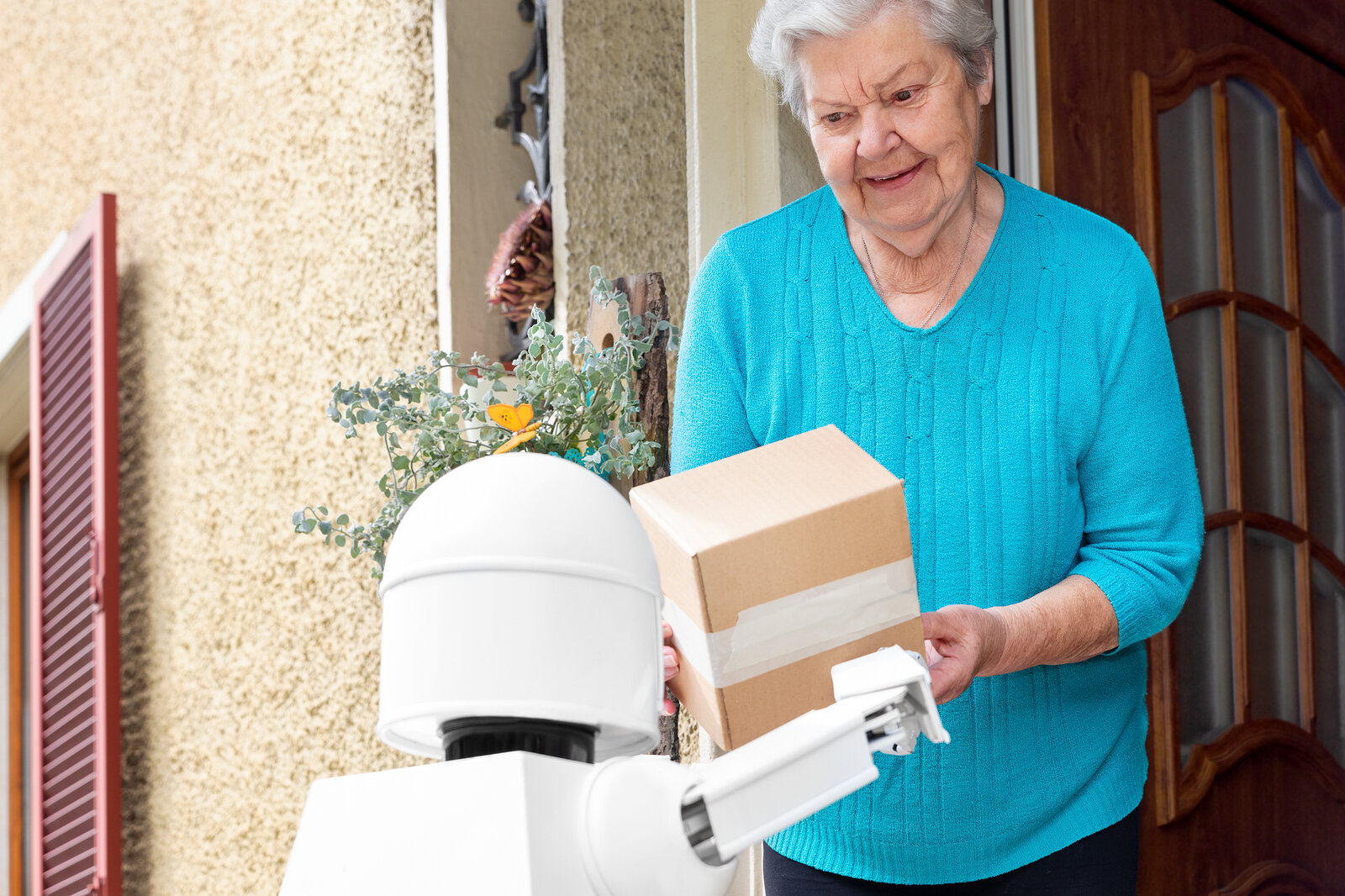 A robot delivering a package to a customer.