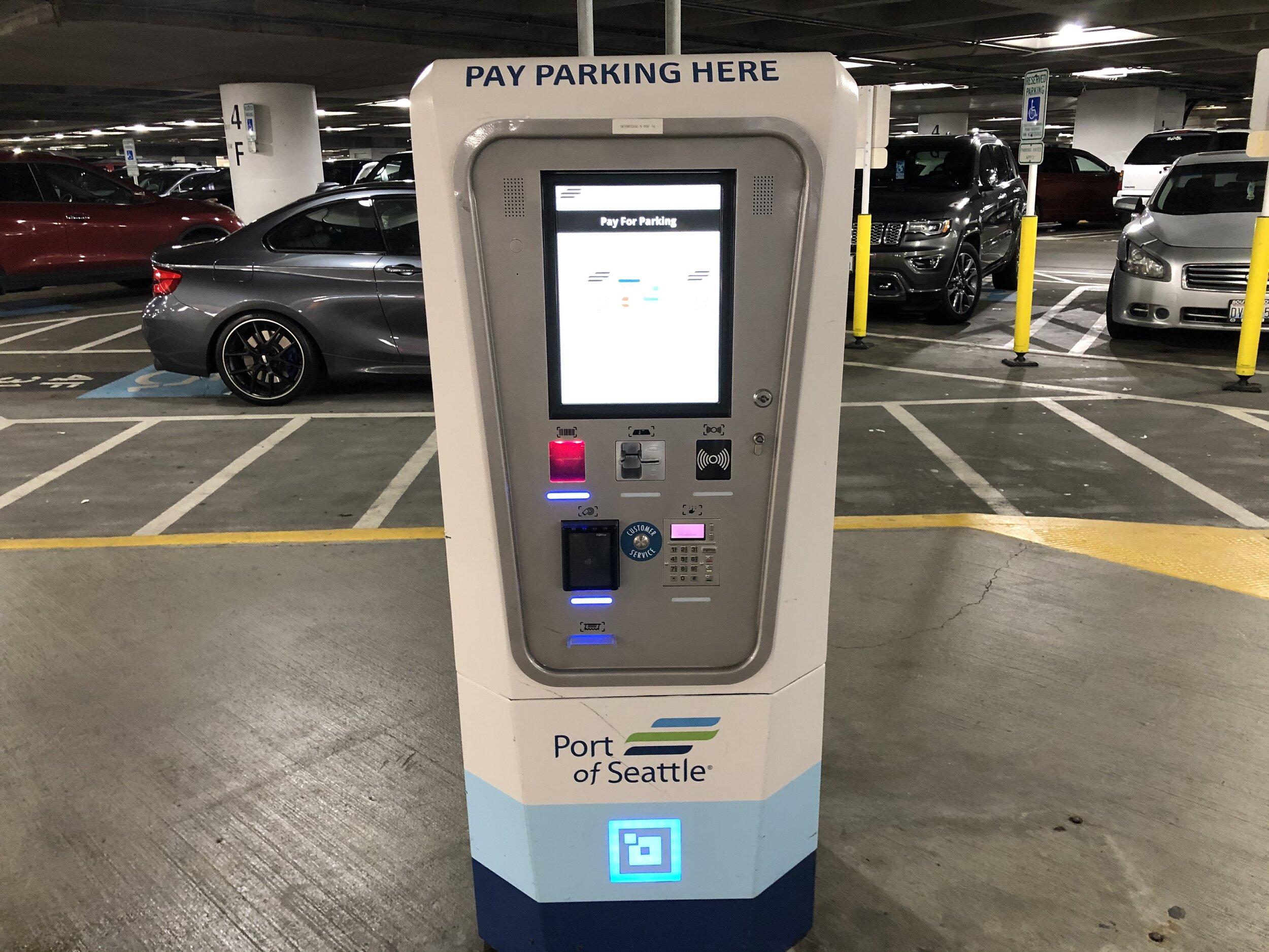 A self-service kiosk in a parking garage.