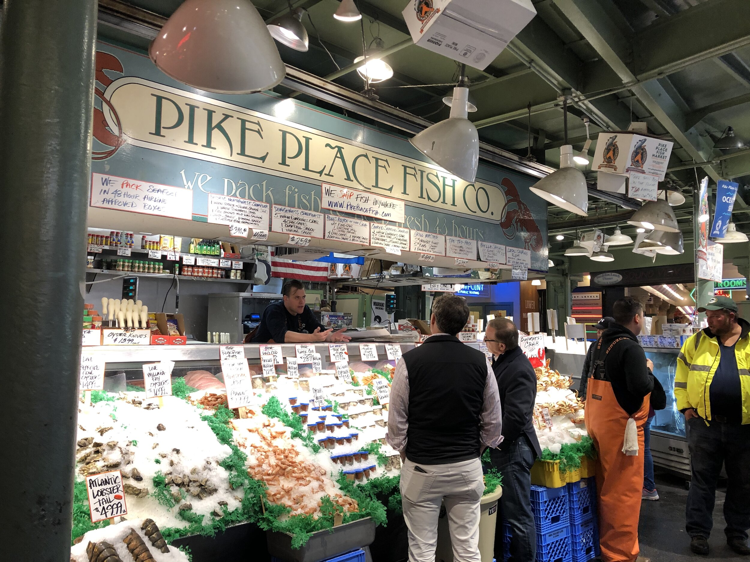 Employees engaging customers at the Pike Place Fish Co.