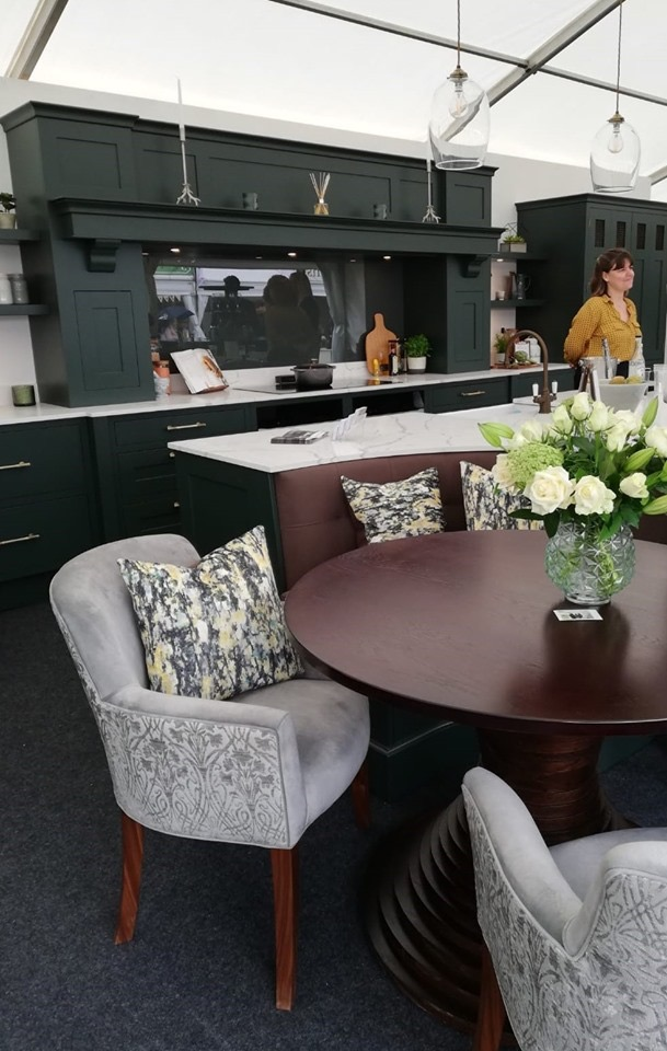 Upholstered walnut dining chairs and banquette seating designed and made for Krantz Designs and featured on their stand at this year's Lincolnshire Show