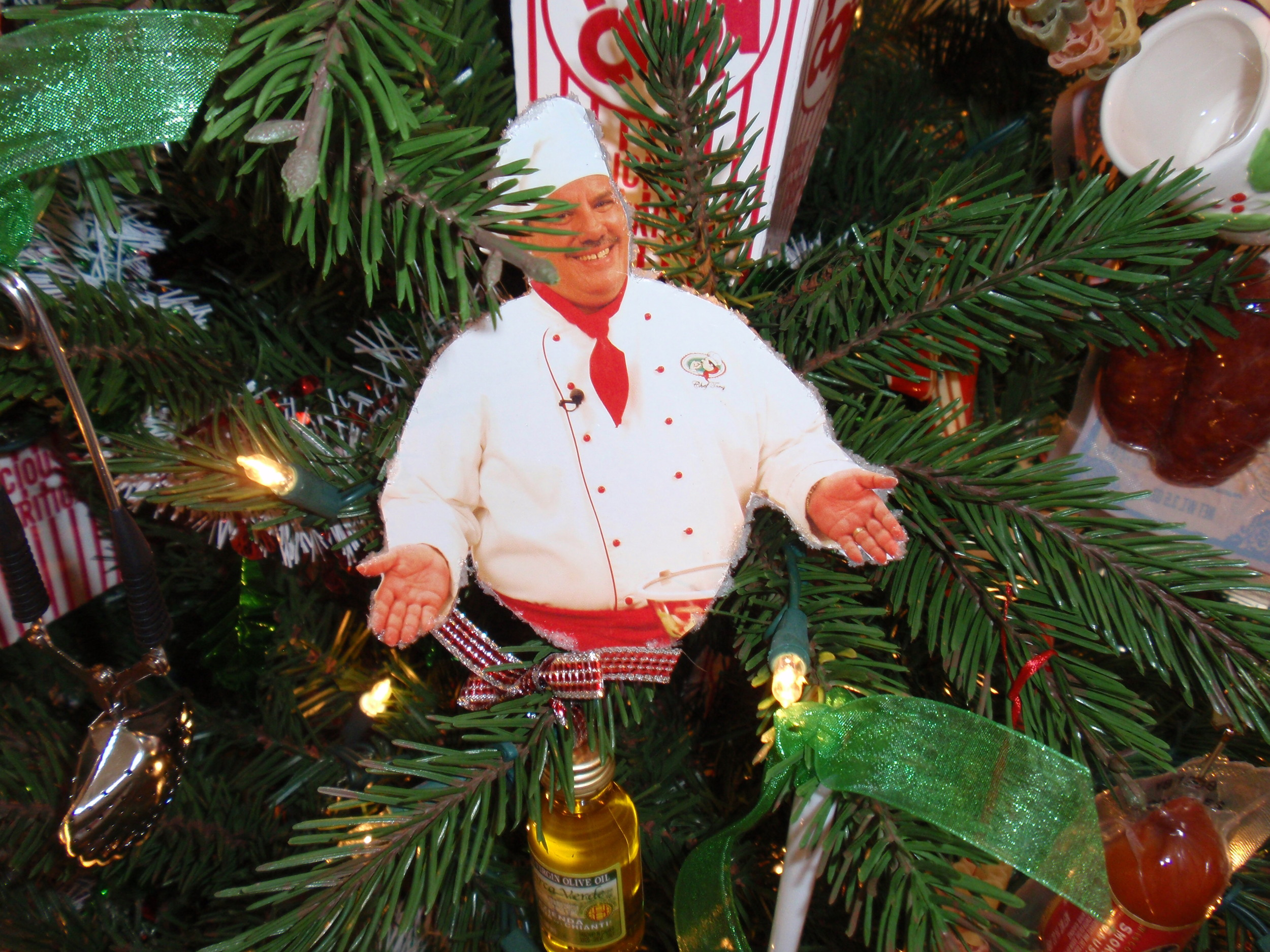BESb Kitchen tree with all food ornaments, here is a homemade Chef Tony ornament.