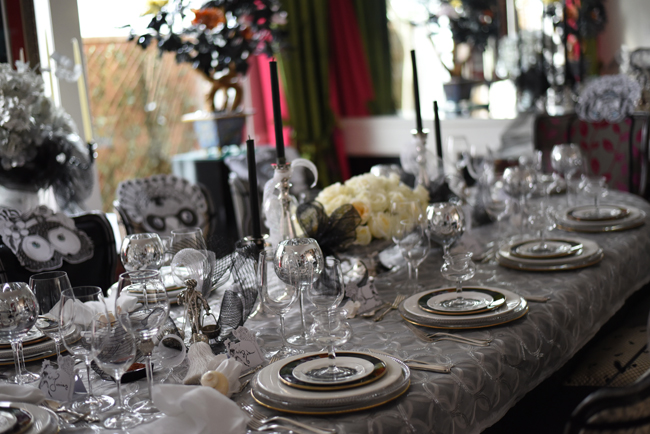 Mirrored wine glasses alongside all the silver (chargers, silver flatware and candle holders) and a sparkly sequined tablecloth makes for a magical dining experience.