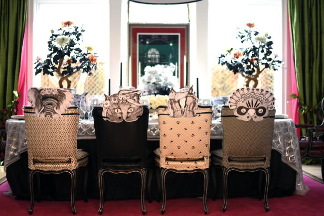 Whimsical black and white masks for guests embellished with glitter decorated the chairs. And what a fun and different conversation starter!
