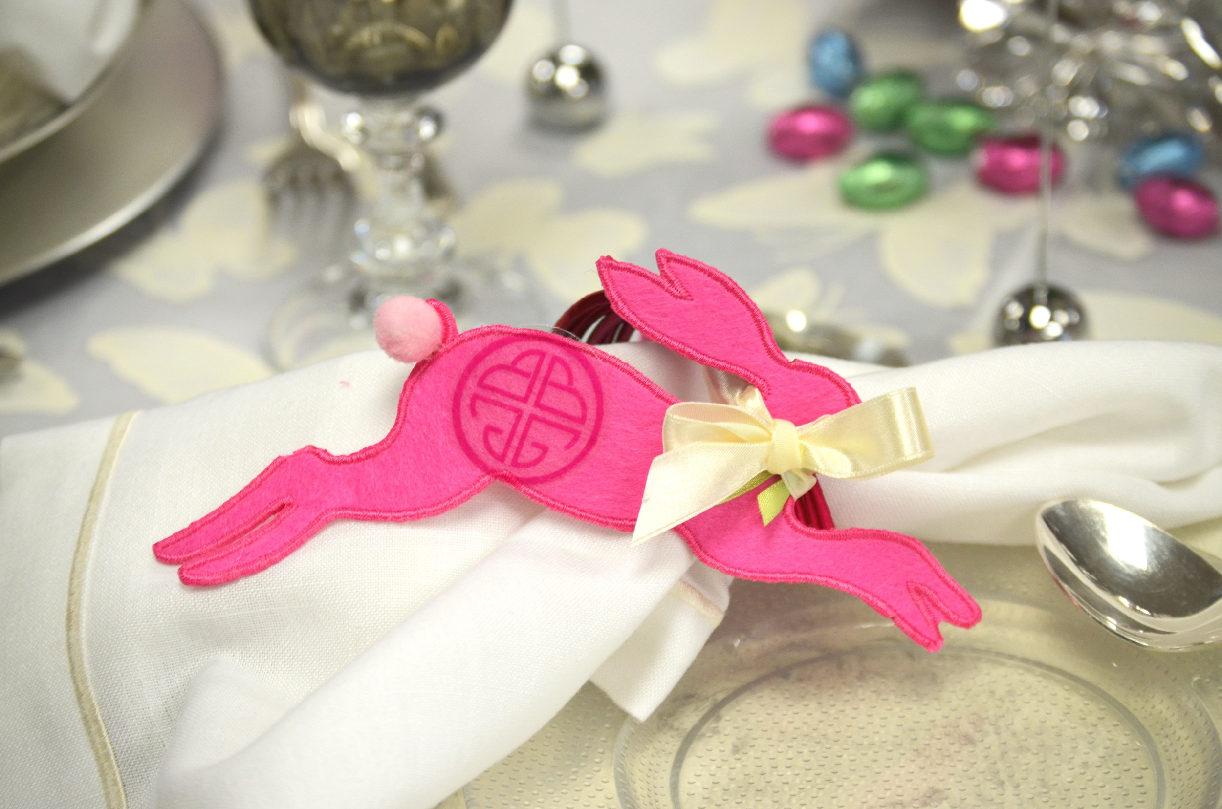 Napkin rings are personalized with a BuDhaGirl bunny and a set of pink  chakra bangles  for each guest.
