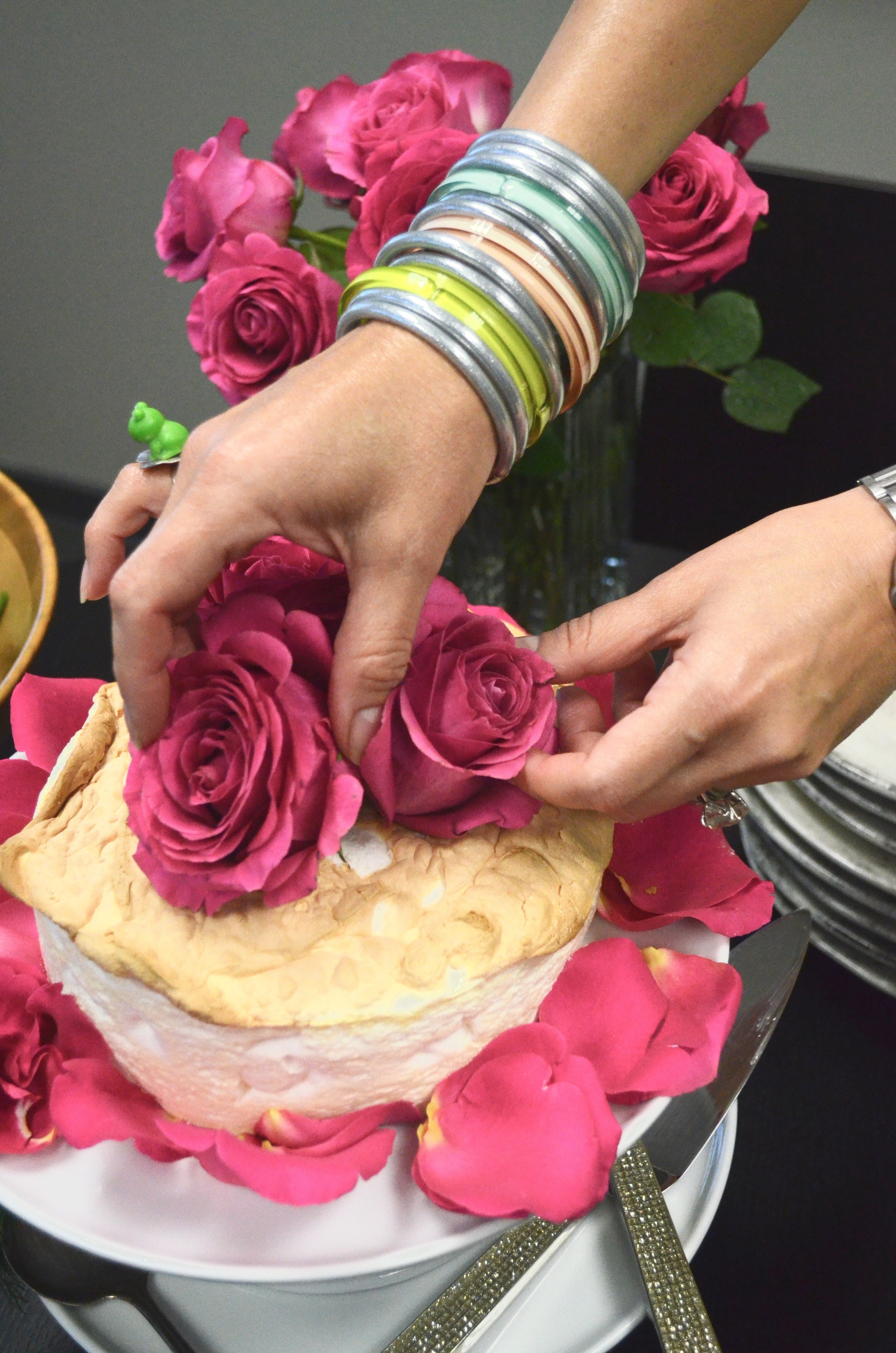 Lemon meringue cake decorated with fresh roses.