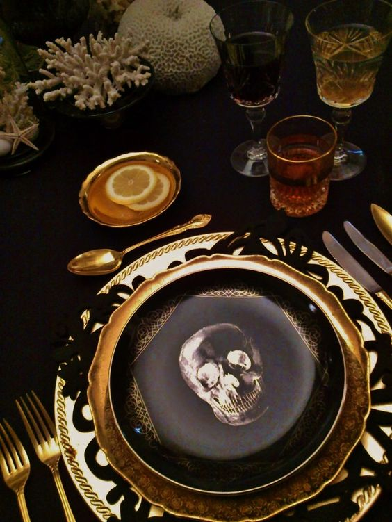 Create a cabinet of curiosities theme on your table by decorating with natural oddities such as shells and skulls.