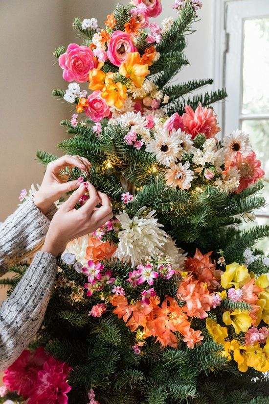 How charming is this? A Christmas tree adorned with freshly cut flowers.
