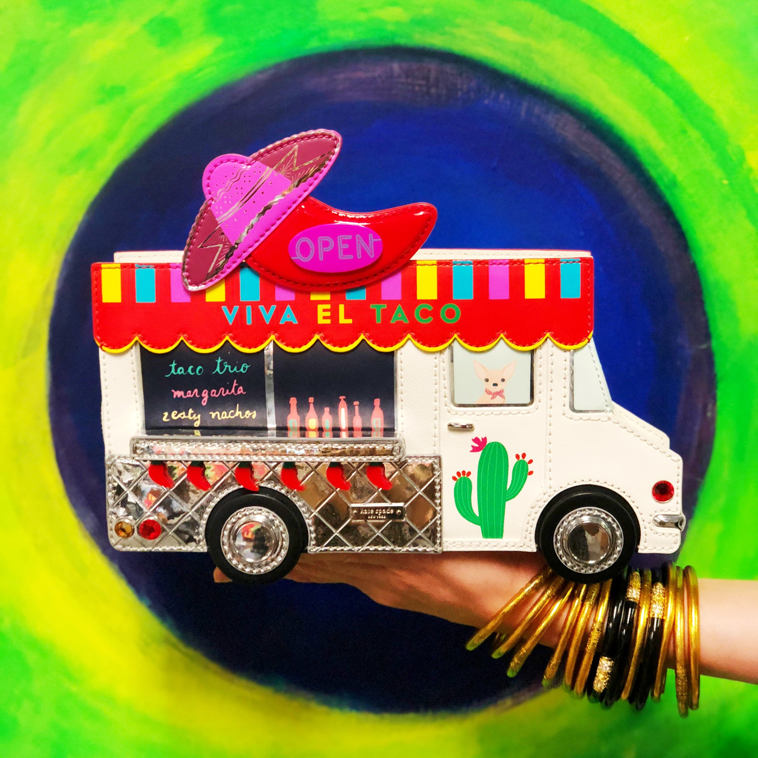 2-in-1: Jessica's Kate Spade taco truck handbag is an ironic tribute to Kate's colorful aesthetic and Anthony's adventurous foodie spirit.