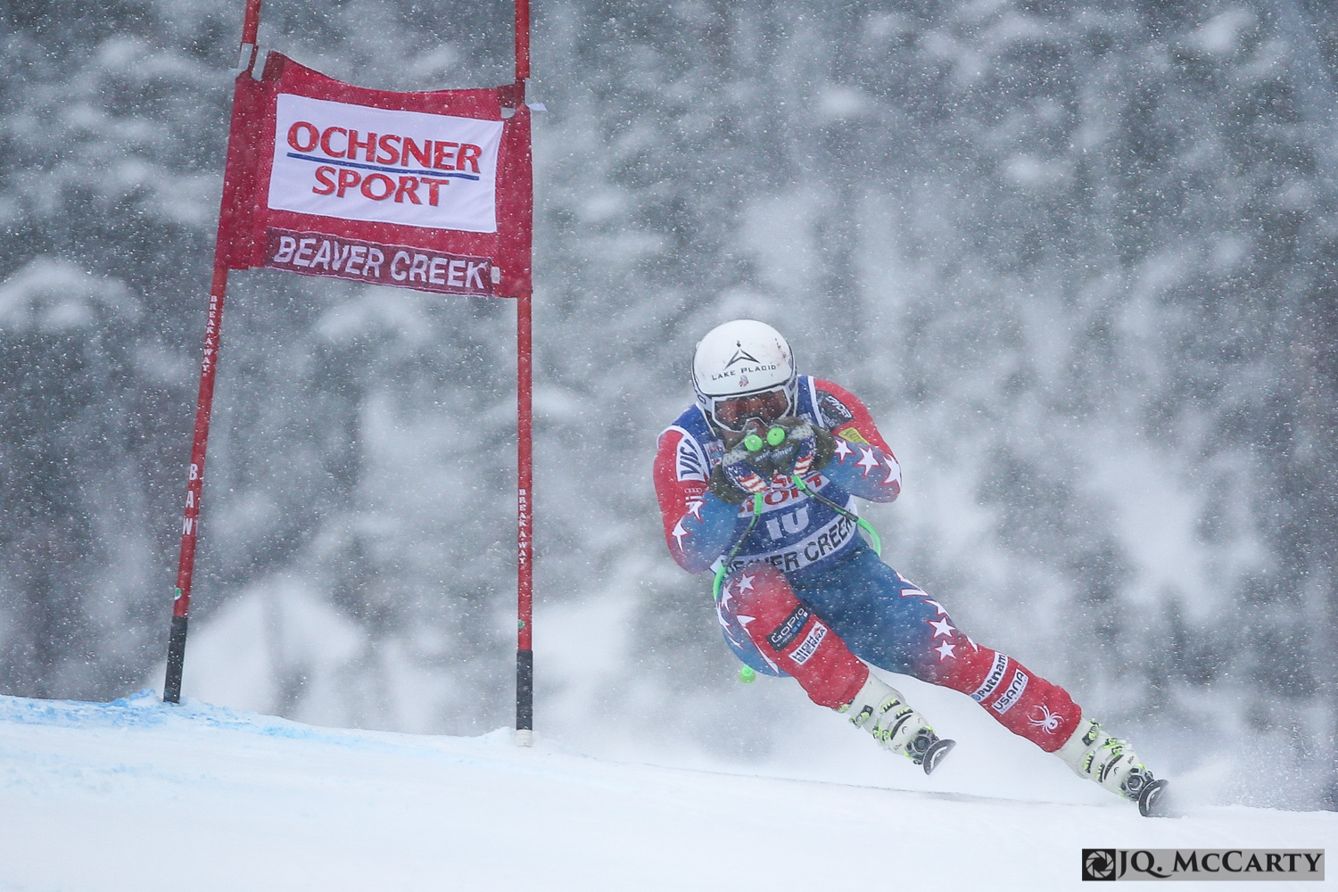 American Andrew Weibrecht speeds past a gate on a snowy day during the Birds of Prey World Cup super-G race Saturday in Beaver Creek. Weibrecht ended up on the podium taking third place with a time of 1 minute, 7.26 seconds.