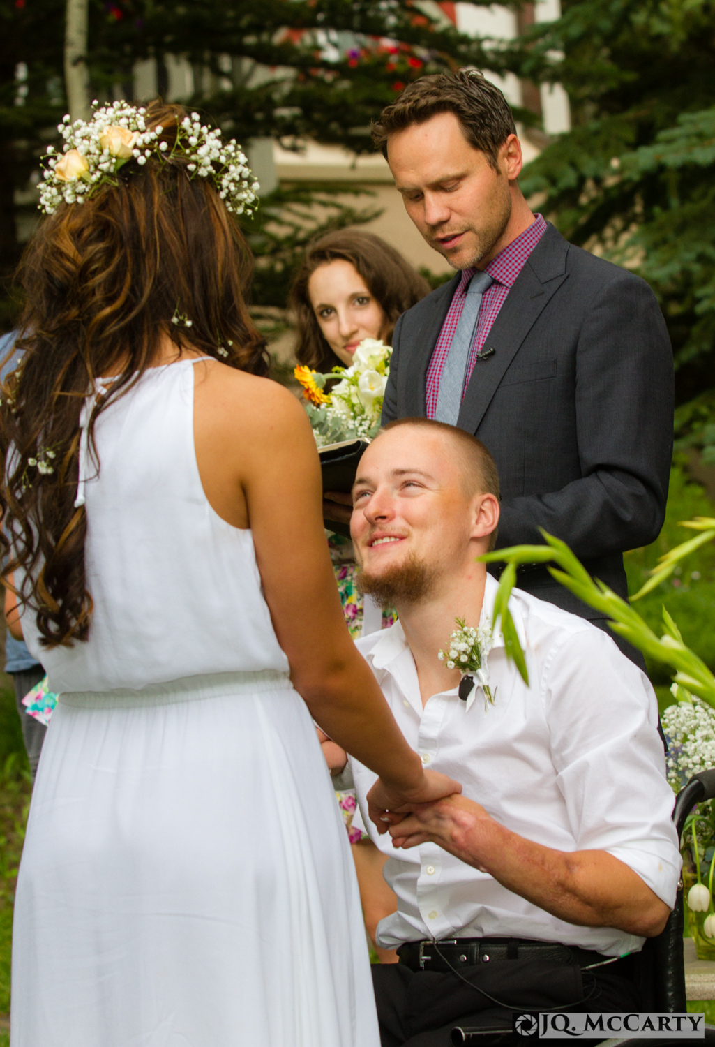 Cpl. Jason Hallett, center, looks into the eyes of his soon to be wife, Rachel MacVean, while Minister Erik Williams performs a last minute impromptu wedding ceremony for the couple Wednesday at the Sonnenalp Hotel in Vail.